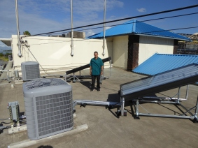 8-feet SunTrac panel powering a 5 Ton 2-stage Carrier air conditioner, installed by JEBSCO Mechanical Inc.
